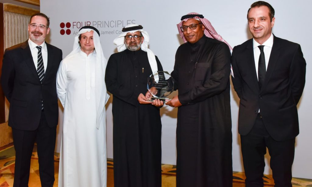 Eng. Saleh Al-Ghamdi and Eng. Abdullah Al Bishi receiving the 'Continuous Improvement Winner Award' and representing National Water Company