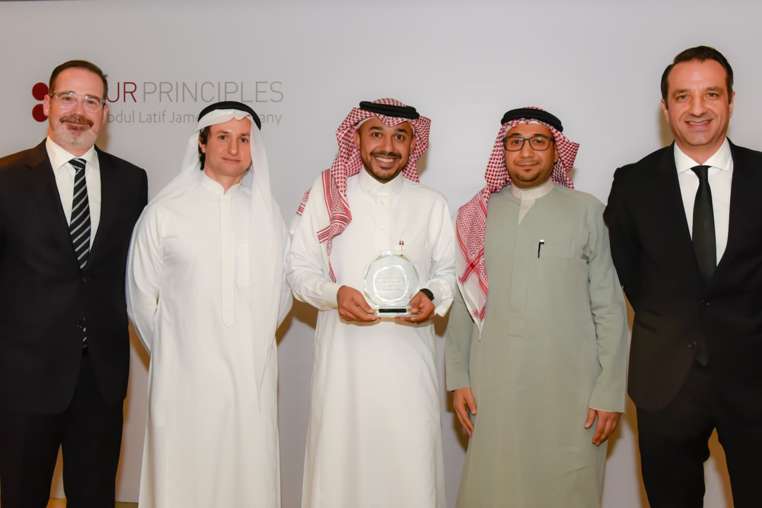 Mr. Murtadha Alalawi and Mr. Abdullah Faisal receiving the 'Lean Transformation' Runner-up Award and representing IKEA Saudi Arabia and Bahrain