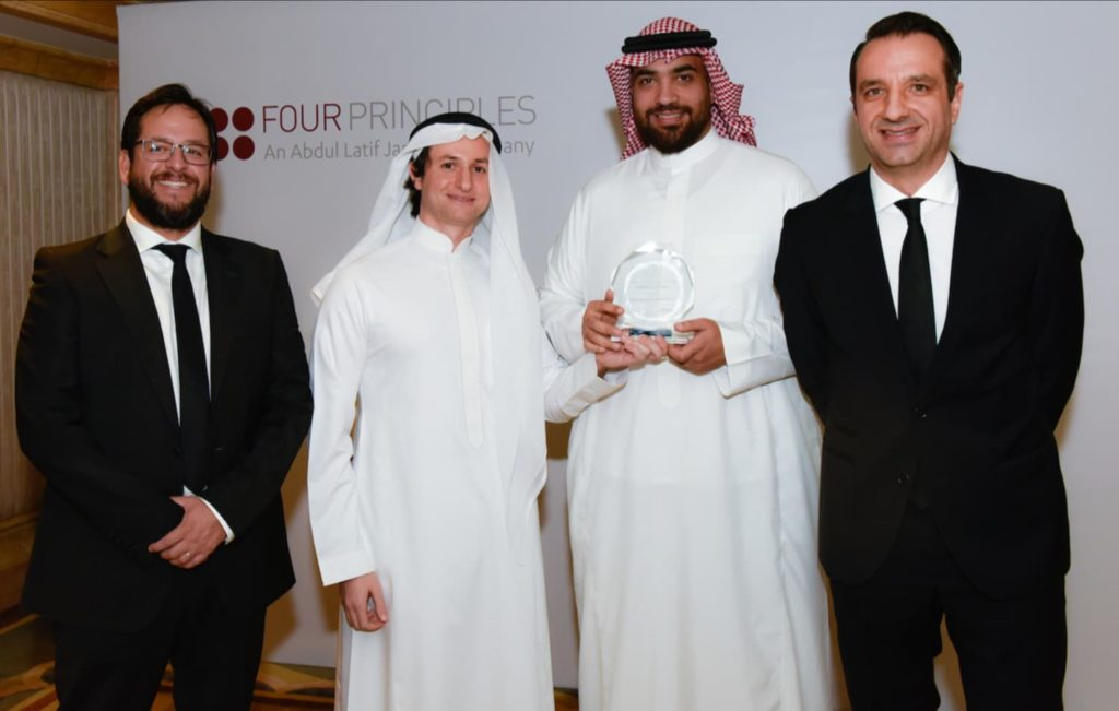 Eng. Sinan Al-Saady receiving the 'Continuous Improvement' runner-up award on behalf of Abdul Latif Jameel United Finance from Seif Shieshakly and Patrick Wiebusch, Four Principles Managing Partners